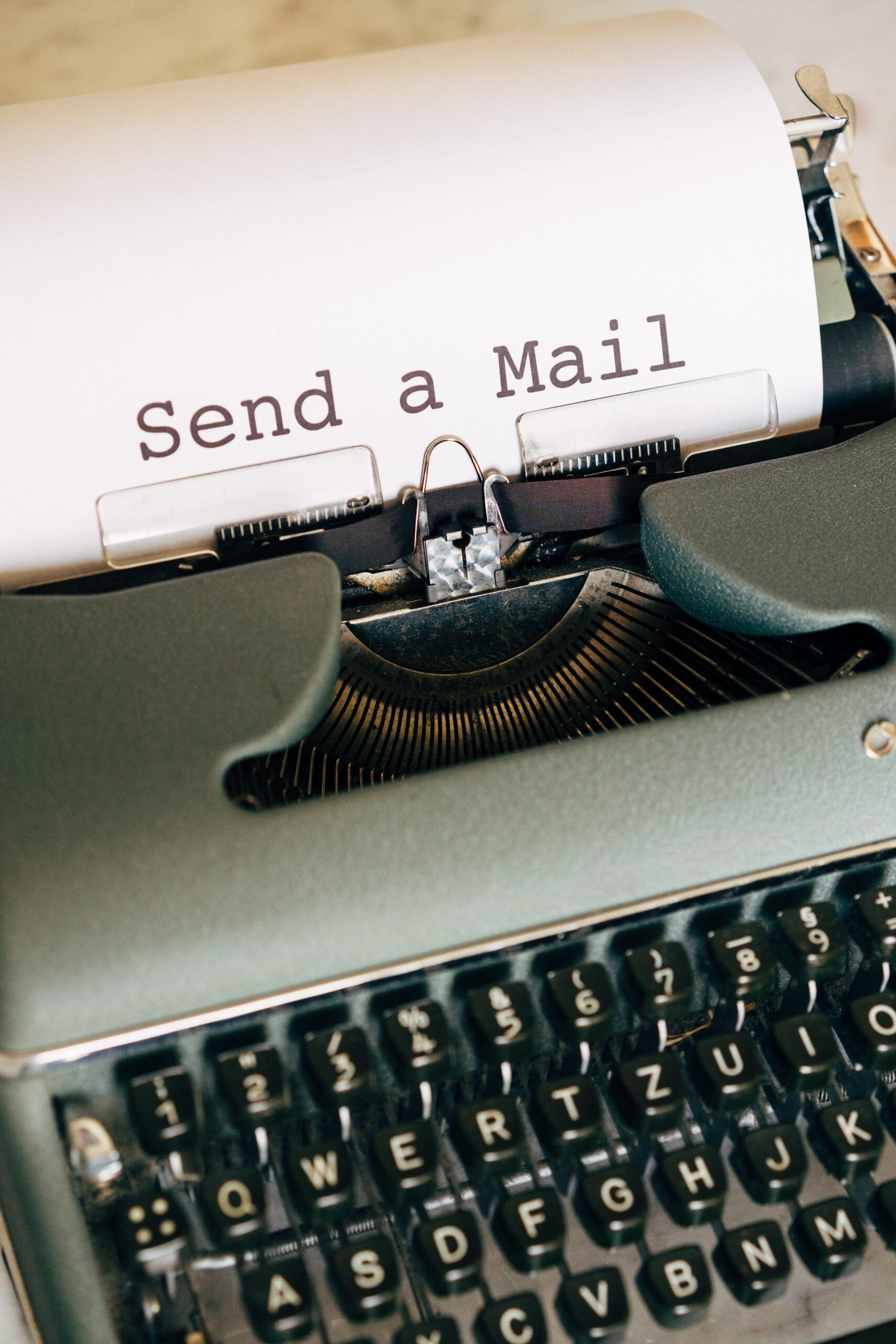 black and white typewriter with white printer paper